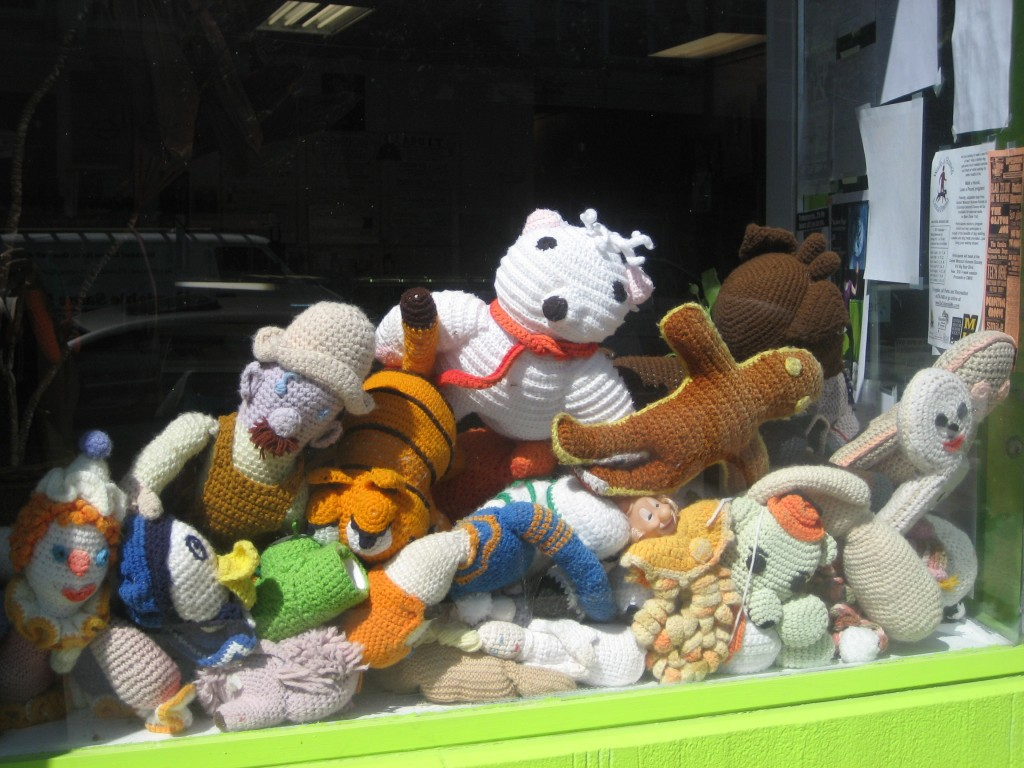 Stuffed animals in the window at Sparky's.