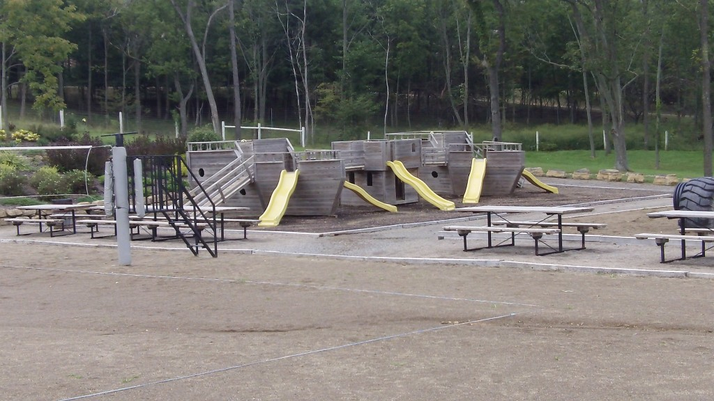 """An """"arc"""" themed playground, picnic area and sand-volleyball courts."""