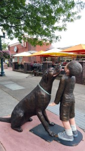 sculpture of puppy licking boy's face in Sioux Falls South Dakota