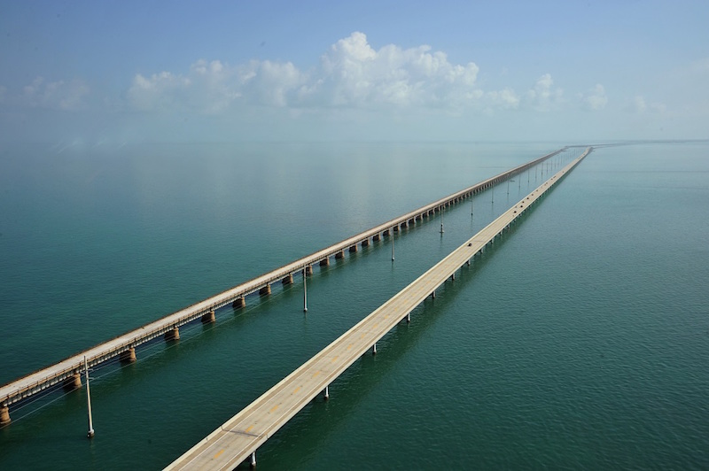 The Seven Mile Bridge looking north towards Marathon, Florida February 22, 2011. The Seven Mile Bridge connects Knight's Key (part of the city of Marathon, Florida) in the Middle Keys to Little Duck Key in the Lower Keys. Among the longest bridges in existence when it was built, it is one of the many bridges on US 1 in the Keys, where the road is called the Overseas Highway. AFP PHOTO/Karen BLEIER (Photo credit should read KAREN BLEIER/AFP/Getty Images)