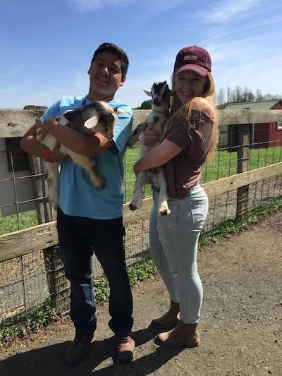 Teens with Goats at Clark's Elioak Farm | Photo Credit: Amanda Hof